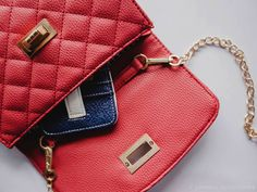 Classic quilted crossbody, with our navy/white team colors credit card sleeve.  Not only classic, but patriotic too.