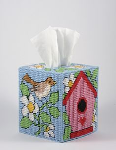 Tissue Box Covers - Celebrate your love for plastic canvas with these eight sweet and stunning tissue box covers -- from an adorable kitty, bright lighthouses, and festive snowbabies to a pretty butterfly, elegant quilted diamonds, and beautiful blossoms. Fill your home with designs for every season and occasion, or create them as handmade gifts from the heart for loved ones! All pieces are worked on 7-mesh plastic canvas using a size 16 tapestry needle and worsted weight yarn. Floss…