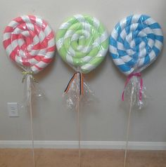 Giant Lollipops for Candyland Birthday Party made out of noodles & ribbon.