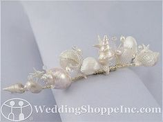 I'm using this as inspiration to make my own, much less expensive mermaid tiara.