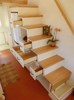 Unita by Oregon Cottage Company - Tiny Living Tansu stairs provide a large number of drawers, plus a full size apartment refrigerator. Tiny House Storage, Small Tiny House, Modern Tiny House, Tiny House Living, Tiny House Plans, Tiny House On Wheels, Tiny House Design, Cottage Living, Living Room
