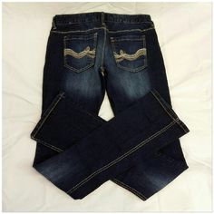 """Rue 21 Jeans, dark wash, size 3/4 Tall Rue 21 Jeans, dark wash, size 3/4 Tall, blue tan cream embroidery back pocket design, dark wash except for washed-out thighs to knees on front and below packets in back, 98% cotton, 2% spandex, 15"""" waist laying flat, 35"""" inseam, 42"""" length waist to hem, 7 1/4"""" length waist to crotch, New Without Tags Rue 21 Jeans"""