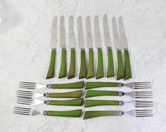 Plastic Handle Cutlery- Antique Picnic Flatware- General Cutlery Stainless Steel-  Green Vintage Bakelite/ celluloid Handles- Set of 17 by BellaVitaVintage on Etsy https://www.etsy.com/listing/289891129/plastic-handle-cutlery-antique-picnic