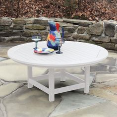 The weather-loving Highwood Hamilton Recycled Plastic Round Adirondack Table is scaled to accommodate four people in style. Perfect for any patio. Green Furniture, Outdoor Furniture, Sustainable Furniture, Outdoor Tables, Outdoor Decor, Round Coffee Table, Recycle Plastic Bottles, Backyard Patio, Recycling