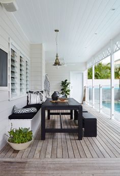 white wooden posts with glass fencing