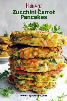 Crispy and pan-fried on the outside with soft, vegetable-filled insides! These Zucchini Carrot Pancakes are a tasty and colourful dish that can be served for #breakfast, #lunch, or as a #snack! #yayforfood | #recipeideas | #vegetarianrecipes | #easyrecipes | #zucchini | #carrots