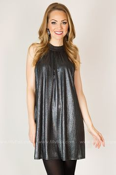 The flattering halter neckline, bold collar, and relaxed silhouette make this dress is a stylish modern pick. The fabric is has a subtle shine and a barely-there stripe that lends aninteresting texture to the look. Wear it to a wedding, a big event, or even just to a memorable date with the one you love. 96% Polyester4% SpandexHand Wash ColdHang or Line DryMade in U.S.A.