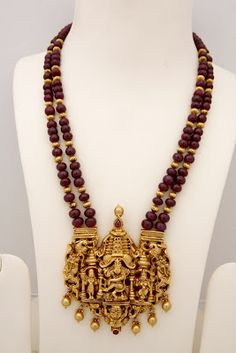 : Antique temple jewellery with ganesh and lord krishna pendants..