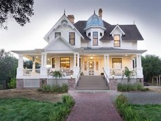 A Lovely White Queen Anne Style home with Copper Roof Turret, combines with Gingerbread Trim and Porch Rails that echo the first Craftsman style of architecture. Exterior View at Dusk Sunset Victorian Manor, Victorian Style Homes, Victorian Farmhouse, Urban Farmhouse, Victorian Interiors, Victorian House Plans, Victorian Design, Fair Oaks California, California Homes