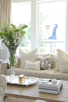 #sofa, #coffee-table, #pillow  Photography: Tracey Ayton - traceyaytonphotography.com  Read More: http://www.stylemepretty.com/living/2014/03/24/the-doctors-closet-home-tour/