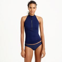 <b>Enjoy free shipping and free returns on our swim collection to the U.S. and Canada. </b>If a halter-neck rash guard doesn't convince you to finally sign up for those surf lessons, we don't know what will.  <ul><li>Hits above hip.</li><li>Wear alone or over a bikini top.</li><li>Nylon/elastane.</li><li>Hand wash.</li><li>Import.</li><li>Online only.</li></ul>