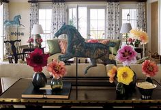 The horses on the hills surrounding the ranch motivated the theme for the living room. A American weather vane in the shape of a galloping horse, spotted on one of Oprah and Ellie's shopping trips, became the centerpiece of the room. Hawaiian Homes, Hawaiian Decor, Oprah Winfrey House, Beautiful Living Rooms, Celebrity Houses, Luxury Interior Design, The Ranch, Decoration, Home And Living