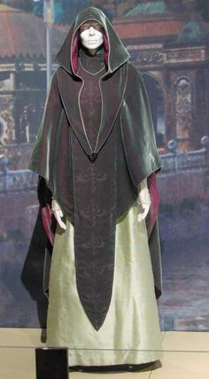These jade and mint green cloaks, made of silk and velvet and shot through with red undertones, are worn by Queen Amidals handmaidens in the final scene of Star Wars Episode I: The Phantom Menace.