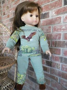 An adult vacation sweatshirt has been used to create this sweatsuit for the doll.  By using selective placement of the pattern pieces, the embroidered eagle becomes the focal point on the front along with the name of the vacation spot.  How cool is that!!
