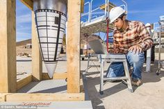 Tyler Keil, lead engineer for a test series using Sandia National Laboratories' Davis gun,...