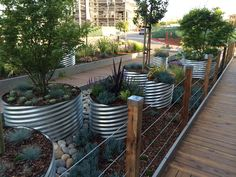 pocket park with galvanized pipe containers                                                                                                                                                                                 More