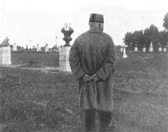 A late photograph of Shoghi Effendi surveying garden developments at Bahjí.