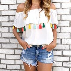 Off the shoulder top with tassels.
