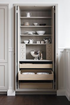 """Concealed behind pocket doors, a closet cupboard is fitted with drawers and shelves """"for storing kitchen machinery and baking utensils."""" For information on importing aKvänum kitchen to the US, write to khk@kvanum.com."""