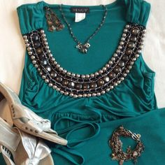 HOST PICK-NWOT VENUS dress, bead/chain detail. Beautiful emerald green VENUS dress with chain and gold/silver stud embellishments. I've never worn this, not one I can wear to my office, but I love this dress!!! Can tie in front or back. Tag says XS but would fit a small. Hits just above the knee. Says XS but I'm a S/M and I can wear it. VENUS Dresses