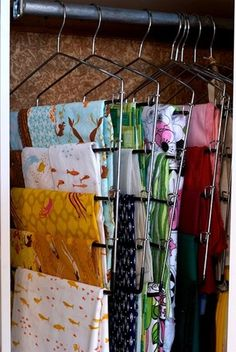 Keep your fabrics from wrinkling by storing them on pant hangers.