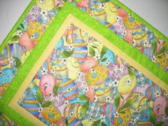 Easter Table Runner with lovely Easter Eggs outlined with metallic  Measures 26 x 15 inches  Made by Chris    This fun small Easter Egg table