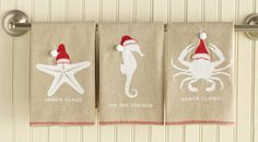"""SEAson Greetings Towel. Add a whimsical beach element to the bath or kitchen. Linen hand towel with blanket stitching detail and santa hat applique. """"Sanda Claus"""" Starfish; """"Tis the Sea-Son"""" Seahorse or """"Santa Claws"""" Crab."""