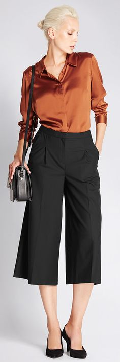 Want a sexy yet sophisticated office look? Go for a silk blouse with culottes. Our work is done.
