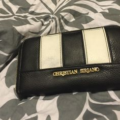 A nice Black and white wallet! This is a nice pretty black and white with some gold wallet on the front! I wore a lot last year so it has some wear but still in great condition! Another one of my favorites but ready to part with it! I think someone will ❤️as much as I did! Christian Siriano Bags Wallets