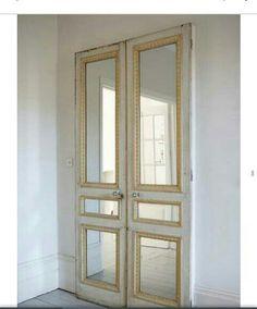 Mirror & molding added to doors. Domino magazine