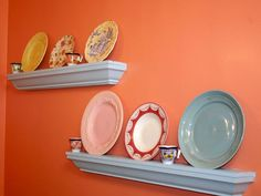 Bright melon painted accent wall houses two single decorative plate shelves on which plates are handsomely displayed against the backdrop of the solid brightly colored background. Plate Shelves, Display Shelves, Shelving, Display Ideas, Shelf, Best Online Shopping Sites, Ebay Shopping, Shopping Tips, Hanging Plates