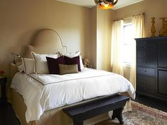 Different textures create a richness to the bedroom.