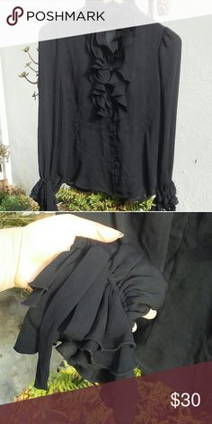 NWT Zara Blacked Ruffle Blouse Sheer black ruffle blouse, ruffled neck, chest and sleeves, buttons down the shirt and collar. There is a keyhole opening on the chest area. The only flaw is the ruffles on the neck area seem very slightly damged. There is also a light marking in the front as shown in the last pic (seems like comes out in wash) Zara Tops Blouses