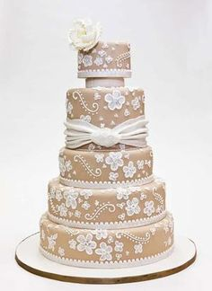 Wedding Cake; Fancy Cakes by Leslie. The design definitely needs to be connected instead of spaced out like that but I thought this one looked fancy.