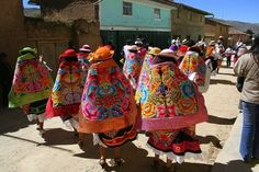 These richly decorated and colorful costumes were worn by dancers, who paraded through the streets of San Pedro de Cajas