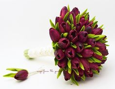 These tulips look so real, you'll be sure they were just picked fresh from the fields for your wedding day! For the bride and groom, this custom Real Touch wedding flower package can be customized for