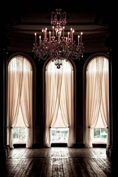If I could build my dream home, it would be small but with ridiculously tall ceilings and windows.