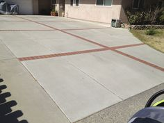 Brick and concrete driveways are also kind of a cool idea.