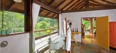 The airy bathroom has both an indoor and al fresco shower that overlooks the forest, and the entire suite opens onto a wooden deck with a private dipping pool fed by spring water.