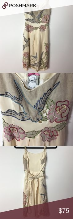 🆕Yoana Baraschi>Silk floral appliqué dress NWOT Stunning and unique silk ivory dress by Yoana Baraschi! Burlap look appliqué with birds, flowers and leaves in blue, pink and green outline. Two side pockets, fully lined. Hidden side zip, attached belt. Shell: 100% silk. Lining: 100% poly. TTS. NWOT. NOTE: Small mark near pocket, see last pic. Not very noticeable and may be removable. Yoana Baraschi Dresses