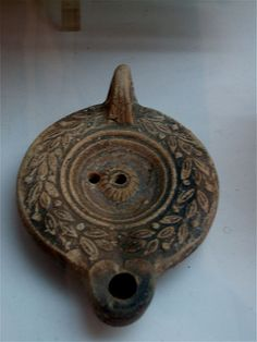 Lampe decoree II Neapolis - Ancient Roman pottery -Lamp decorated with figurative motifs. Origin Cap Bon - Tunisia. Ist-IInd century AD. Exposed in the Nabeul Museum