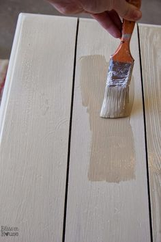 How to create a faux reclaimed wood look on a solid painted wood table top using just a circular saw and paint.