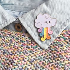 Rainbow Cloud pins measure around 3 cm wide and 4 cm high with a lapel pin back with a butterfly clasp. This pin design is limited. Pin comes attached to a designed paper backing. Designed by Little Dipper. Thanks for looking