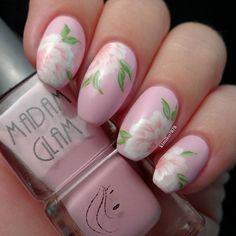 Pink flower inspired nail art design.