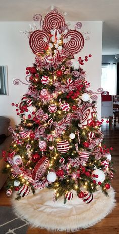 Part of my inspiration for a peppermint tree. This is not mine. Elegant Christmas Trees, Creative Christmas Trees, Christmas Tree Themes, Noel Christmas, Holiday Tree, Christmas Tree Toppers, Beautiful Christmas, Christmas Tree Decorations, Gingerbread Christmas Tree