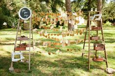 escort cards hanging on string suspended between ladders! // photo by bvaphoto.com