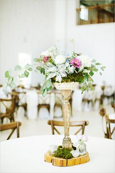 #elegant #weddingcenterpiece at a #barnwedding @weddingchicks