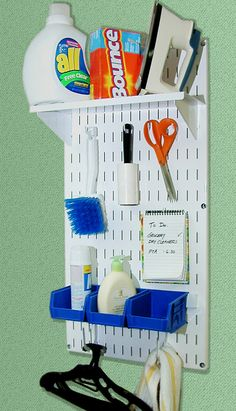 Laundry room pegboard storage and organization with Wall Control white metal peg boards