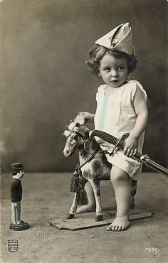 Little boy on toy horse                                                       …