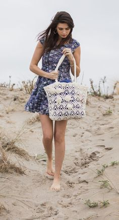 Worked in a delicate crochet lace pattern and embellished with a cascade of roses, this oversize Beach Rose Tote is slightly stiffened after crocheting so that it maintains its shape.